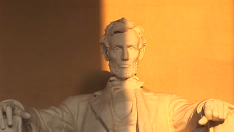 President-Lincoln-S-Sculpted-Face-Is-Seen-Half-In-Shadow-The-Other-Half-Bathed-In-Golden-Light