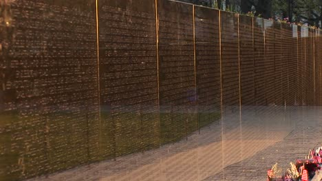 Close-Up-Of-The-Vietnam-Veterans-Memorial-Wall-With-Tributes-And-Mementos-In-Front
