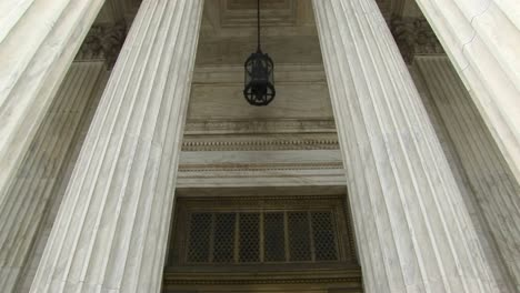 View-Of-Columns-A-Hanging-Lamp-And-Bronze-Doors-At-The-West-Entrance-Of-The-Supreme-Court