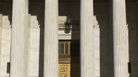 Sunlight-Reflects-On-The-Bright-White-Pillars-Of-The-Us-Supreme-Court-Building-Entrance
