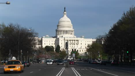 Traffic-Flows-In-Many-Directions-On-The-Treelined-Streets-In-Front-Of-The-United-States-Capitol-Building