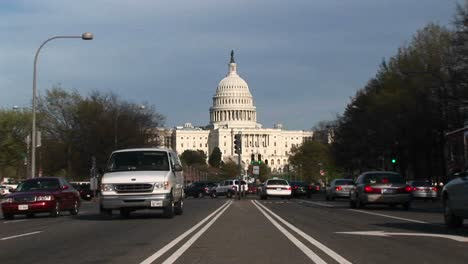 View-Tracksin-On-The-United-States-Capitol-Building-In-The-Background-Of-Streets-Flowing-With-Traffic