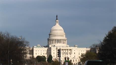 Camera-Zooms-To-A-Medium-Shot-Of-The-Us-Capitol-Building-S-Weddingcake-Dome-Topped-By-The-Massive-Statue-Of-Armed-Freedom