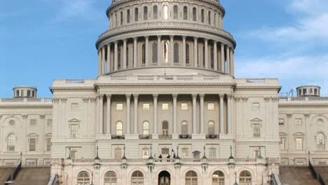 The-Camera-Pans-Up-The-Us-Capitol-Building-In-Washington-Dc-From-Ground-Level-To-Its-Landmark-Rotunda-And-Dome
