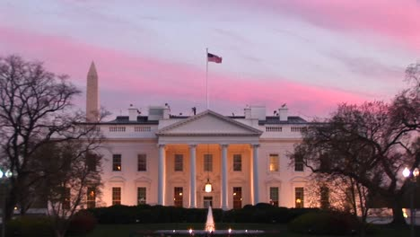 Pale-Pink-And-Blue-Streaks-Form-A-Colorful-Backdrop-Behind-The-White-House