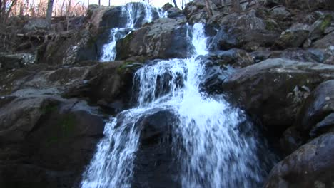 The-Camera-Pans-Up-A-Waterfall