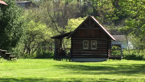 A-Small-Rustic-Log-Cabin-Sits-Surrounded-By-Idyllic-Country-Scenery