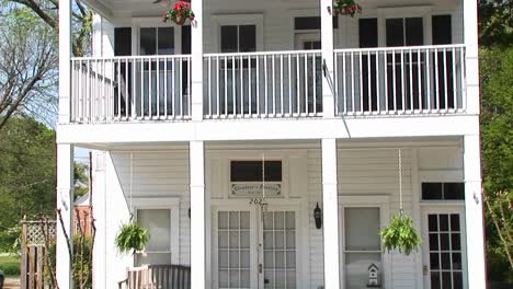 A-Charming-Old-House-In-The-Country-With-A-Welcoming-Secondstory-Porch