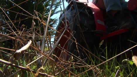 A-Man-Mowing-With-A-Small-Tractor-Drives-Past-The-Camera