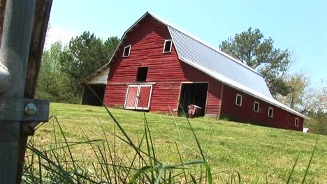 A-Lovely-Old-Red-Barn-Sits-On-Top-Of-A-Hill
