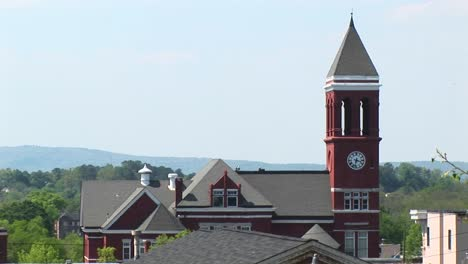 An-Old-Clock-Tower-Stands-Tall-Above-The-Town-S-Rooftops