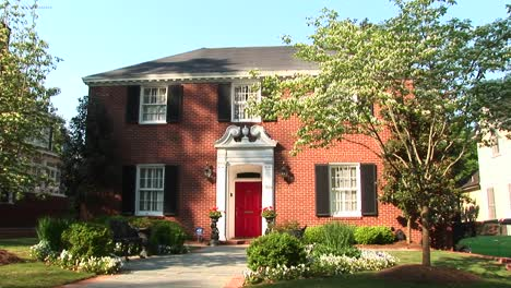 A-Traditional-Red-Painted-Door-Beckons-A-Welcome-To-This-Beautiful-Colonial-Revival-Home