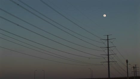 Longshot-The-Full-Moon-Hanging-Above-Power-Lines
