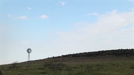 Longshot-Of-A-Windmill-Standing-In-A-Pasture-In-Texas