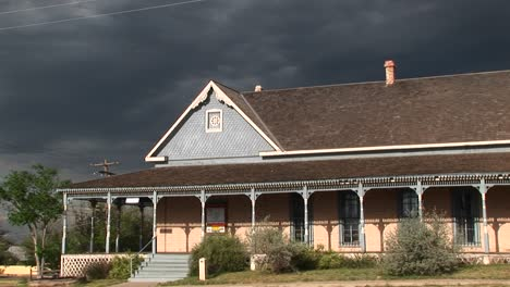 Mediumshot-Of-A-Ranch-House-With-Storm-Clouds-Building-Behind