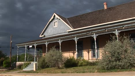 Mediumshot-Of-A-Ranch-House-As-Storm-Clouds-Gather-Behind-It