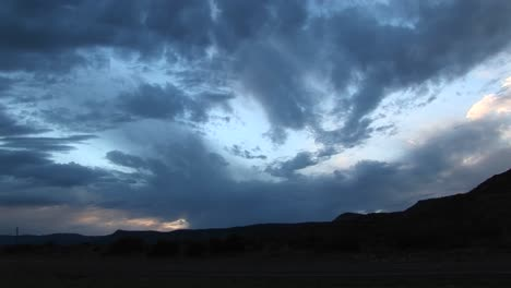Panright-Shot-Of-Storm-Clouds-Over-A-Hilly-Landscape