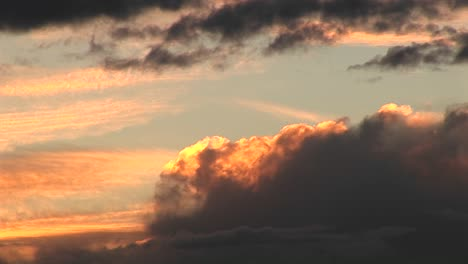 Mediumshot-Of-Storm-Clouds-Rolling-Into-Golden-Clouds