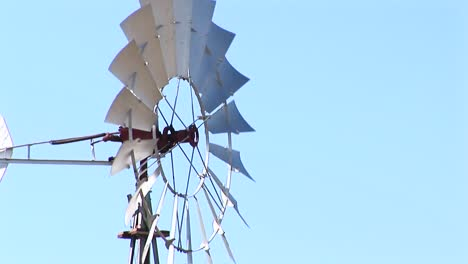Mediumshot-Of-Windmill-Blades-Spinning-In-The-Wind