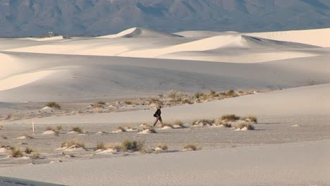 Longshot-Of-A-Hiker-Walking-Through-White-Sands-National-Monument-In-New-Mexico