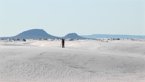 Longshot-Of-A-Photographer-Setting-Up-A-Tripod-In-White-Sands-National-Monument-In-New-Mexico
