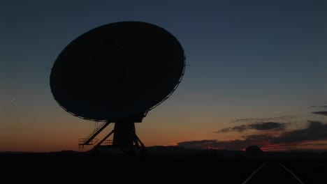 Mediumshot-Of-A-Silhouette-Of-A-Satellite-Dish-In-The-Array-At-The-National-Radio-Astronomy-Observatory-In-New-Mexico