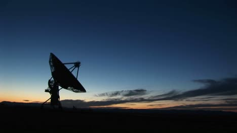 Longshot-Of-A-Silhouette-Of-A-Satellite-Dish-In-The-Array-At-The-National-Radio-Astronomy-Observatory-In-New-Mexico
