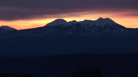 Longshot-Of-The-La-Sal-Mountains-Silhouetted-Against-A-Golden-Sky
