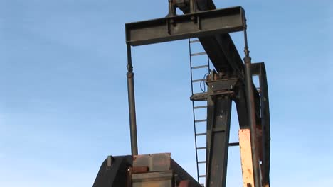 Closeup-Of-An-Oil-Pump-Turning-In-The-New-Mexico-Desert-1