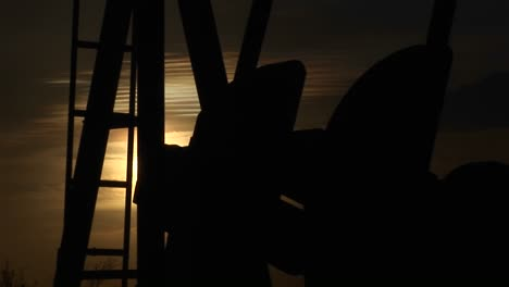 Closeup-Of-A-Silhouetted-Oil-Pump-Turning-In-The-New-Mexico-Desert