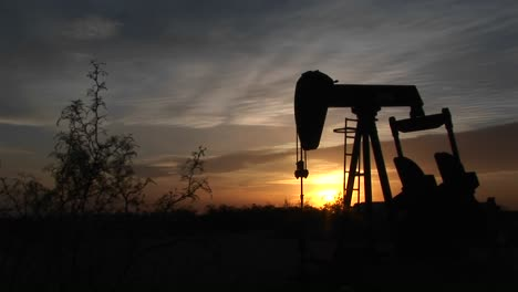 Medium-Shot-Of-A-Silhouetted-Oil-Pump-Turning-In-The-New-Mexico-Desert-3