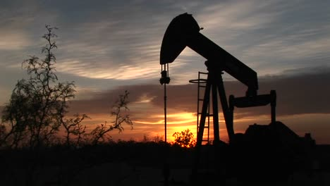 Medium-Shot-Of-A-Silhouetted-Oil-Pump-Turning-In-The-New-Mexico-Desert-4