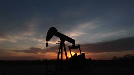Medium-Shot-Of-A-Silhouetted-Oil-Pump-Turning-In-The-New-Mexico-Desert-5