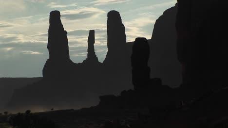 Medium-Shot-Of-The-Silhouetted-Three-Sisters-Rock-Formation-In-Monument-Valley-Tribal-Park-Arizona