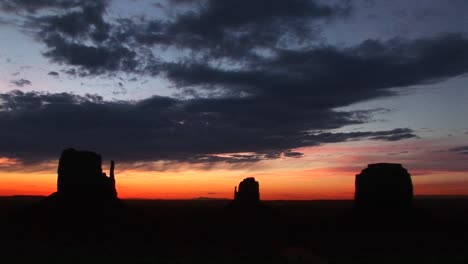 Long-Shot-Of-The-Mittens-In-Monument-Valley-Arizona-Silhouetted-At-Goldenhour