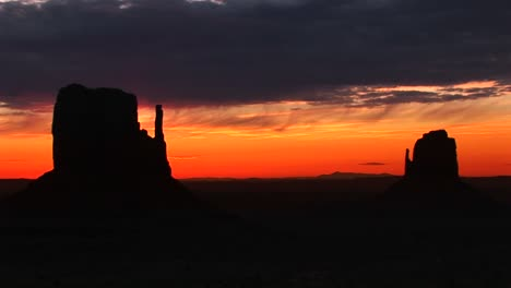 Longshot-Of-Silhouetted-Mittens-In-Monument-Valley-Arizona-At-Goldenhour