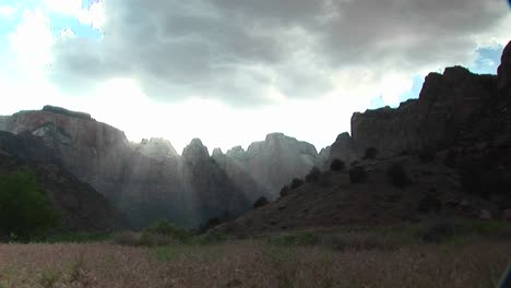Long-Shot-Of-Rays-Of-Sunlight-Filtering-Over-Mountain-Peaks-In-Zion-National-Park