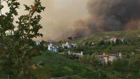 Long-Shot-Of-Fire-Raging-And-Smoke-Billowing-Around-A-Southern-California-Community