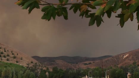 Panleft-Shot-Of-Smoke-Billowing-From-A-Wild-Fire-Raging-Near-A-Southern-California-Community