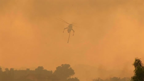Following-Shot-Of-A-Helicopter-Dropping-Chemicals-On-A-Wildfire-In-California-1