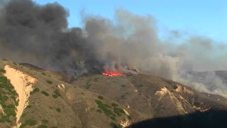 Long-Shot-Of-Wildfires-Burning-On-A-Ridge-In-Southern-California