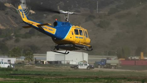 A-County-Fire-Fighting-Helicopter-Lands-In-A-Field