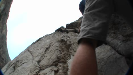 Panup-Past-A-Rock-Climber-Scaling-A-Cliff-Face