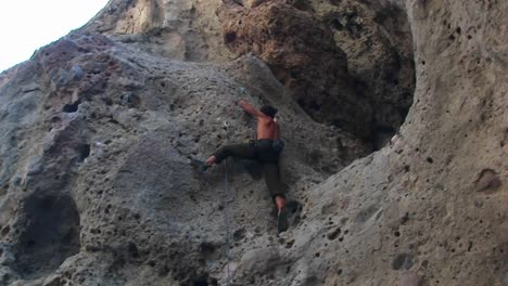 Panright-Of-A-Rock-Climber-Scaling-A-Cliff-Wall