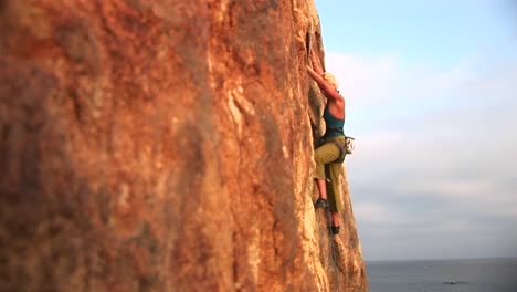 Panright-Of-A-Rock-Climber-Attempting-To-Climb-A-Cliff-Wall-Over-The-Pacific-Ocean