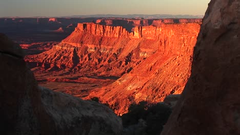 Mediumshot-Of-Buttes-Being-Bathed-In-The-Orange-Sunset-Glow-At-Canyonlands-National-Park-Utah
