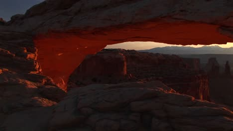 Pandown-Of-Mesa-Arch-To-Reveal-And-Frame-Distant-Mountains-Inside-Canyonlands-National-Park