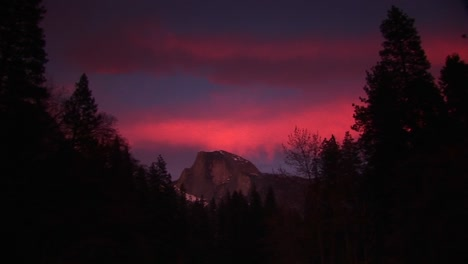 Wide-Shot-Of-Red-Sky-Above-Half-Dome-In-Yosemitenationalpark