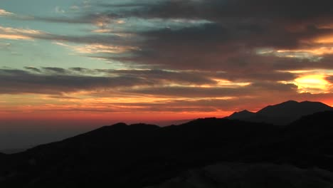 Panright-Of-A-Fiery-California-Sunset-To-A-Rockclimber-Hanging-From-An-Overhanging-Rockface