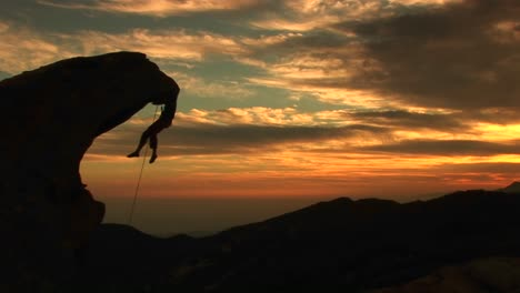 Mediumshot-Of-A-Rockclimber-Silhouetted-By-The-Setting-California-Sun